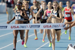 Mary Cain, right, lost by a stride to Treniere  Moser in the women's 1500-meter run at the USA Championships June 22, 2013, in  Des Moines, Iowa. (AP Photo/Charlie Neibergall)