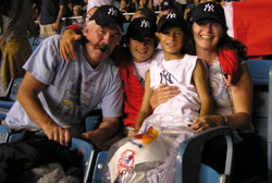 Brendan and Patty Finn, with their two adopted sons, enjoy a game at Yankee Stadium.