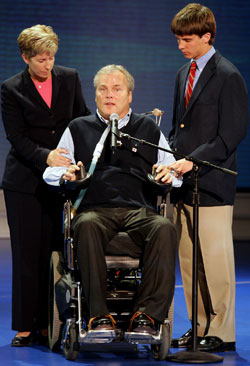 In this 2004 photo, Police Officer Steven McDonald is shown with his wife, Patti Ann, and their son, Conor, who has since joined the New York Police Department.