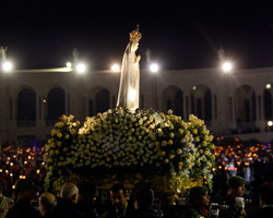A statue of Our Lady of Fatima is carried during a candlelight vigil attended by Pope Benedict XVI at the Marian shrine of Fatima in central Portugal May 12, 2010. (CNS photo/Hugo Correia, Reuters)