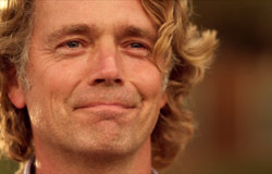 John Schneider plays Hannah's loving, strong, protective dad.